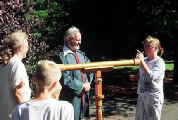 Galileo impersonator Mike Francis showing telescope